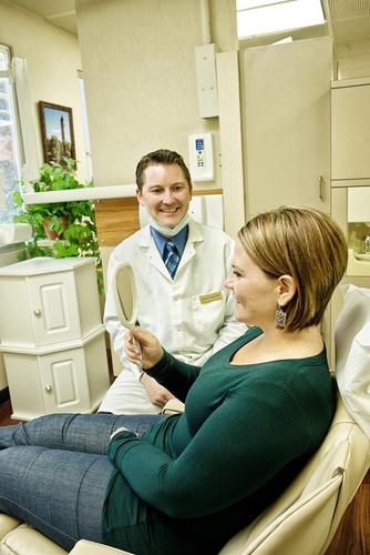 A dentist informing a patient about her teeth.